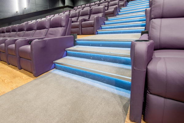 Dansk Wilton delivered Colortec carpets to support the luxury and comfort of the cinema halls and corridors and increase sound quality for The movie theatre BIG BIO