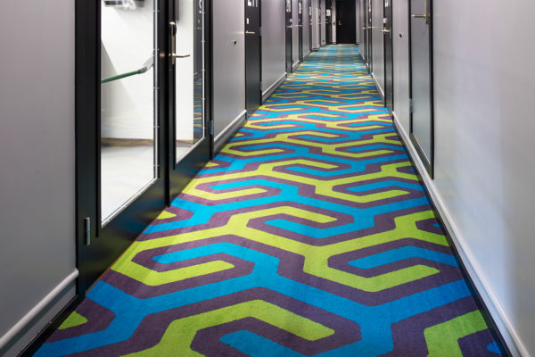 Dansk Wilton has delivered custom designed Colortec carpets for corridors, stairs, conference rooms, lounge, restaurant and suites as well as area rugs for the reception area and the suites at Thon Hotel Rosenkrantz in Oslo