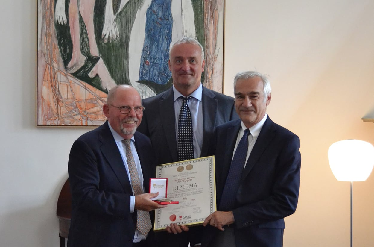 Dansk Wilton's Italian Partner Francesco Giordano received in 2016 the Diploma of the Danish Export Association and his Royal Highness Prince Henrik's Medal of Honor in recognition of outstanding services to trade relations between Denmark and Italy