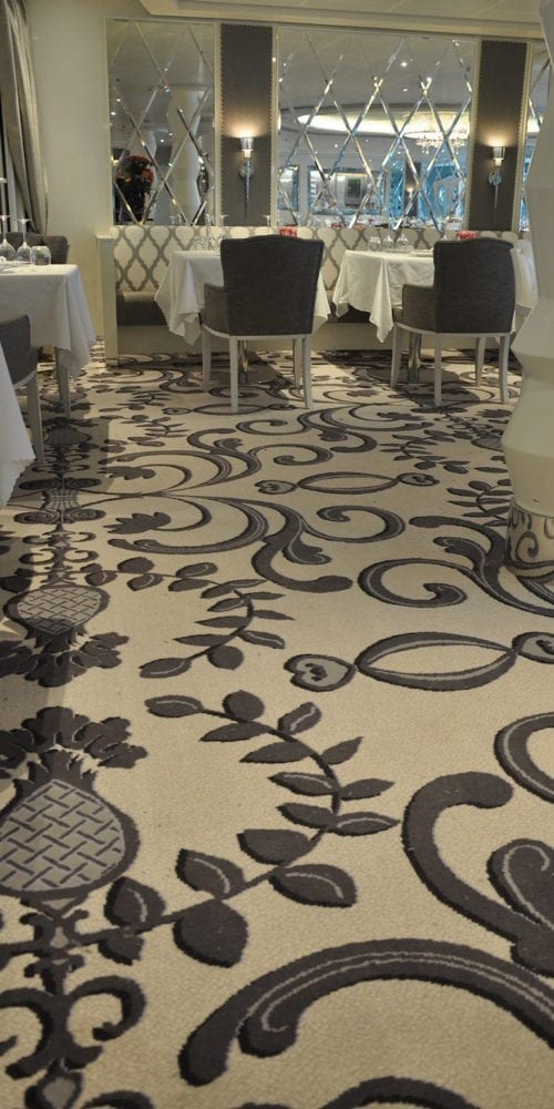 Beautiful carpet solutions for the restaurant at hotel Costa Neoromantica, delivered by Dansk Wilton