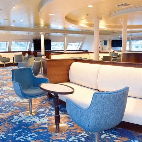 Lounge aboard National Geographic Quest with carpets from Dansk Wilton